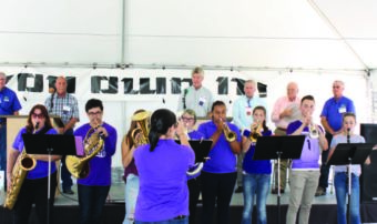 Young wind instrument musicians performing together