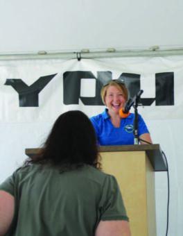 Woman speaks at podium