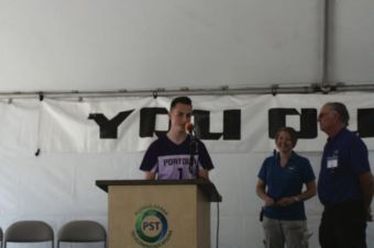 A young man speaks at a podium
