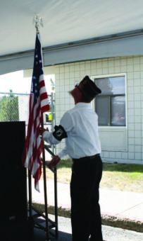 Man raises American flag