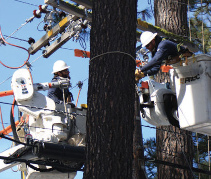 lineworkers working on power poles