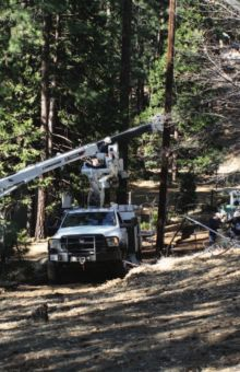 The southend crew gets ready to replace a pole on Grizzly Road. Photo by Emily Compton