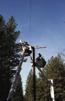 Journeyman Lineman Jon Pilatti and Southend Foreman Mitch Carr get a pole ready to be replaced. Photo by Emily Compton.