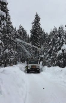 The southend crew works to restore power during a snow storm. Photo by Mitch Carr