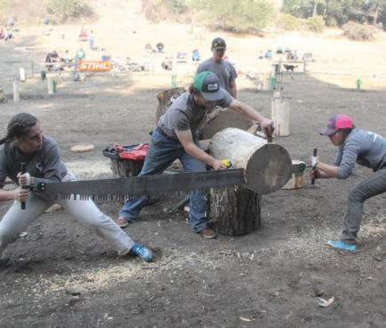 student team competing in log sawing event