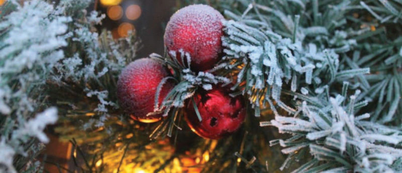 snow covered Christmas ornaments on tree