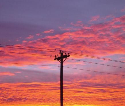 power line against a sunset sky