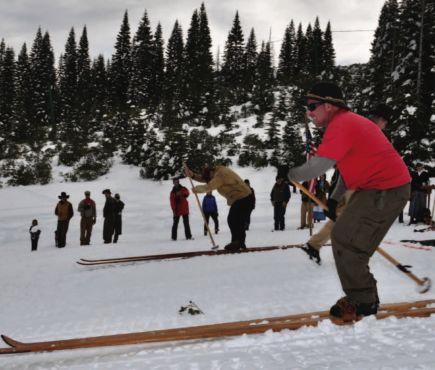 Plumas Ski Club President, Donald Fregulia, on long skis on snowy hillside