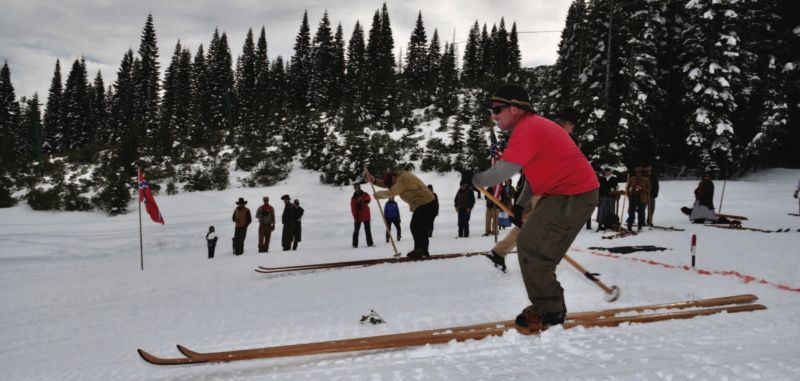 Plumas Ski Club President, Donald Fregulia, on long skis on snowy hillside