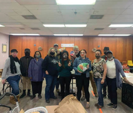 Fort Sage Family Resource Center volunteers put together food boxes for families impacted by the Laura Fire in 2020